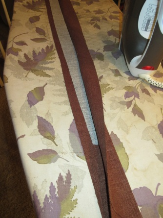 Ironing the fusible hair canvas next to the crease