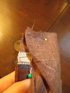 Waistband folded back onto itself, enclosing the fly part